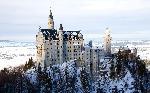 Photo du chateau sous la neige Neuschwanstein en Bavière en Allemagne