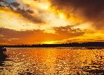 Photo coucher de soleil sur une riviere en Argentine