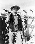 Photo noir et blanc de John Wayne en shérif